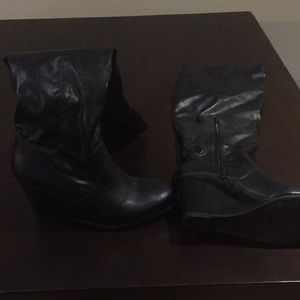 Knee high wedge black leather boots